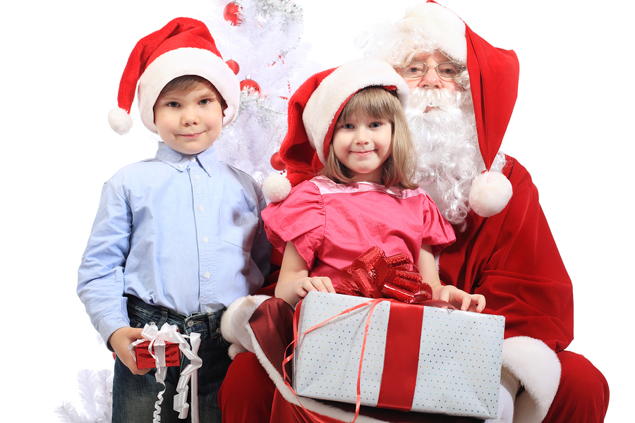 Santa and boy giving gifts to girl