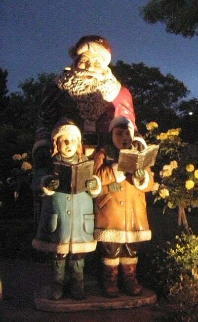 Santa and children singing carols