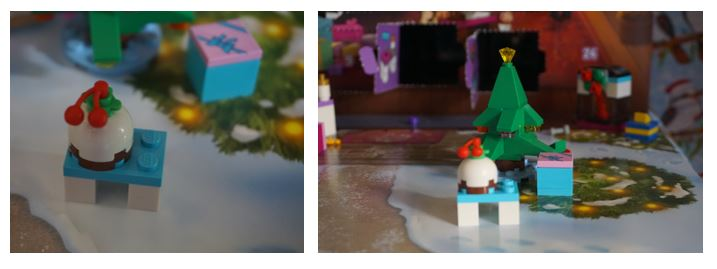 Lego Christmas pudding in front of a Christmas tree