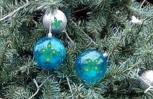 Christmas baubles decorated with the Australian scout symbol (stylised fleur-de-lys)