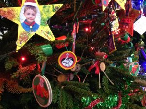 Scout badges and photo stars hanging on a Christmas tree